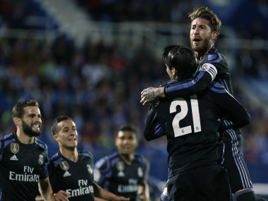 Real Madrid's Alvaro Morata, second right, celebrates with teammates after scoring. AP