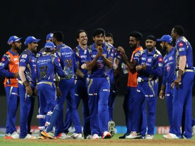 Mumbai Indians players celebrate the wicket of Aditya Tare on Saturday. IPL/Sportzpics