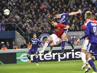 Anderlecht's Leander Dendoncker, center right, scores against Manchester United. AP