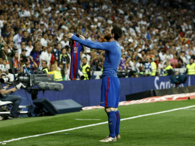 Lionel Messi celebrates in front of Real Madrid fans after winning the El Clasico for Barcelona in the 93rd minute. AFP