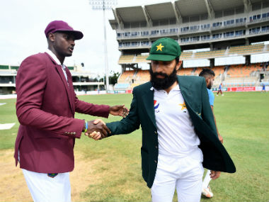 Pakistan's Misbah-ul-Haq shakes hands with West Indies captain Jason Holder. AFP
