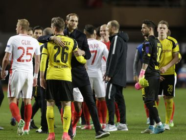 Thomas Tuchel hugs Dortmund's Lukasz Piszczek after the Champions League match. AP