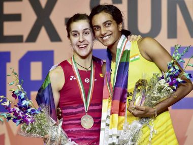 India's PV Sindhu with Carolina Marin, celebrates after winning the India Open title. PTI