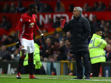 Jose Mourinho, manager of Manchester United gives instruction to Paul Pogba. Getty