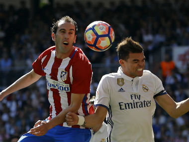 Pepe and Diego Godin challenge for the ball in the Madrid derby. AP