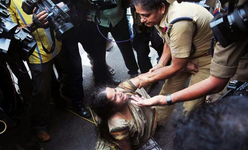 Jishnu Prannoy's mother was manhandled and dragged on the street by Kerala Police on WEdnesday. Firstpost/Naveen Nair