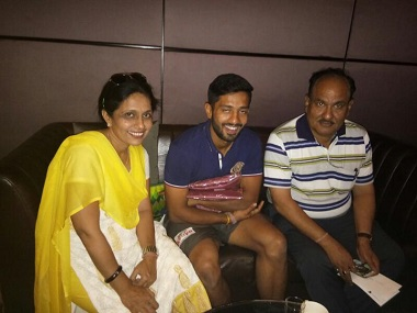 Rahul Tripathi with his parents. Image courtesy: Colonel Tripathi