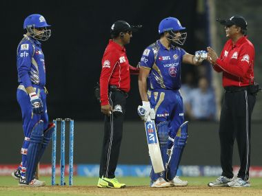 Mumbai Indians captain Rohit Sharma talks with the umpires. Sportzpics/IPL