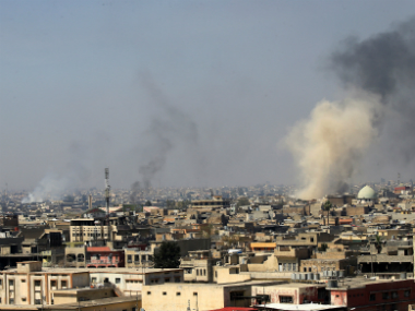 Smoke rises over the city during a battle against Islamic State militants, in Mosul, Iraq on 25 March. Reuters