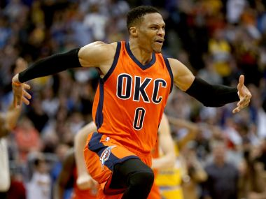 Oklahoma City Thunder's Russell Westbrook celebrates after scoring a game-winning, three-point shot at the buzzer against Denver Nuggets. Getty Images