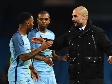 Pep Guardiola, manager of Manchester City, with Raheem Sterling and Fernandinho. Getty