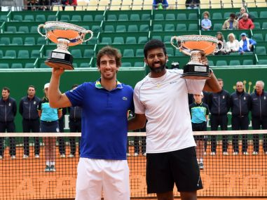 Rohan Bopanna and his partner Pablo Cuevas with the men's doubles trophy. Getty