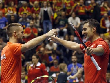 Serbia's Nenad Zimonjic, right, and his partner Viktor Troicki celebrate after winning their Davis Cup quarter-final. AP