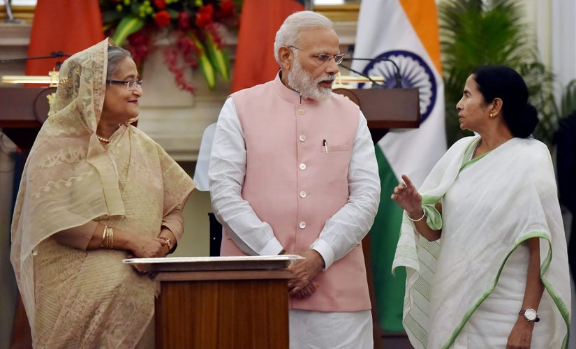 Prime Minister Narendra Modi with his Bangladeshi counterpart Sheikh Hasina and West Bengal CM Mamata Banerjee in New Delhi on Saturday. PTI