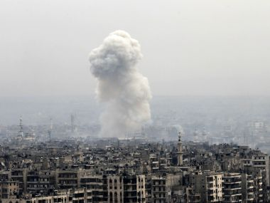 Smoke rises following a Syrian government air strike on rebel positions, in eastern Aleppo. AP