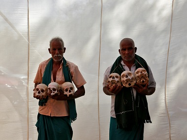 Farmers from Tamil Nadu display skulls of their peers who have committed suicide. Reuters