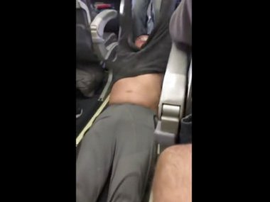A passenger was forcefully removed from a United Airlines flight in Chicago on Sunday. Video of police officers dragging the passenger from an overbooked United Airlines flight sparked an uproar on social media. AP