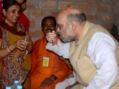 BJP president Amit Shah during his visit to Goranga Nagar area in Rajarhut near Kolkata on Thursday. PTI