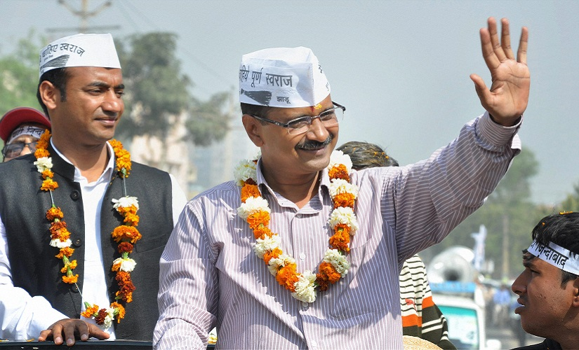 Faridabad : AAP convener Arvind Kejriwal during an election road show in Faridabad on Saturday. PTI Photo (PTI3_22_2014_000048A)