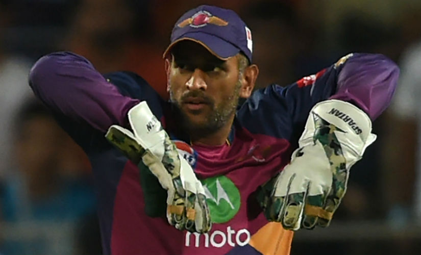 RPS' MS Dhoni in action during the IPL 2017 match against MI. AFP