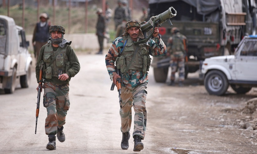 Indian Army soldiers arrive at the site of a gunbattle with suspected militants in Chadoora, on the outskirts of Srinagar, Kashmir. Reuters