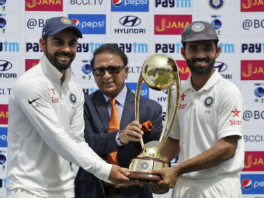 Virat Kohli (L) and Rahane pose with the Border-Gavaskar Trophy after winning the Test series against Australia. AP