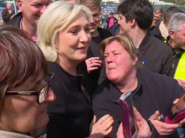 Far-right French presidential candidate Marine Le Pen, left, is greeted by workers outside a Whirlpool home appliance factory in Amiens, France, on Wednesday. AP