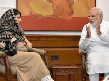 Jammu and Kashmir Chief Minister Mehbooba Mufti and Prime Minister Narendra Modi. PTI
