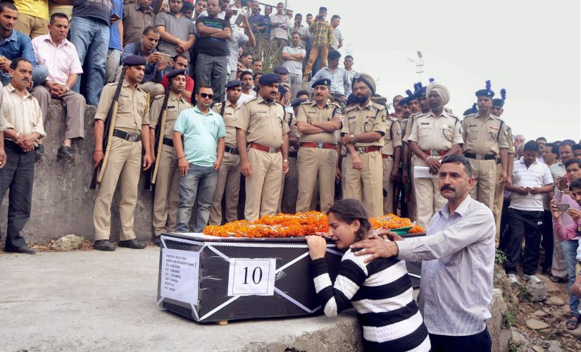 Daughter of a martyred CRPF jawan at his funeral in Dharamsala. PTI