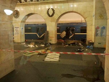 A subway train hit by a explosion stays at the Tekhnologichesky Institut subway station in St Petersburg on Monday. AP