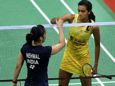 PV Sindhu greets Saina Nehwal after beating her in the quarterfinal match of the India Open 2017. PTI