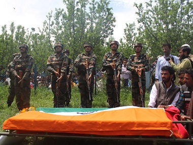 Soldiers pay respect to Lieutenant Ummer Fayaz at his funeral on Wednesday. Firstpost/Sameer Yasir