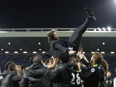 Chelsea manager Antonio Conte is thrown in the air by his players as they celebrate winning the Premier League title. Reuters