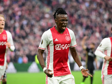 Ajax's Bertrand Traore struck twice to hand a huge advantage against a strong Lyon side. AFP