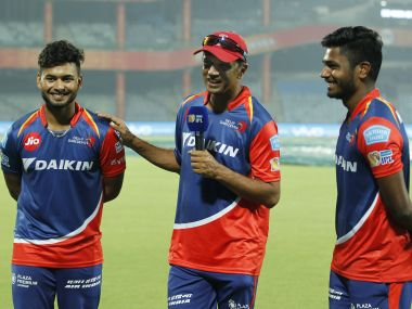 Rishabh Pant (left) and Sanju Samson (right) with coach Rahul Dravid after the match against Gujarat Lions. Sportzpics/IPL