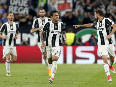 Juventus' scorer Dani Alves, front center, and his teammates celebrate their side's second goal. AP
