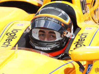 Fernando Alonso pulls out of the pits during practice. Reuters