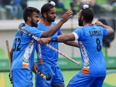 File photo of India's Sardar Singh with teammates. AFP