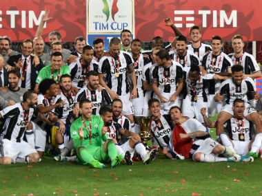 Juventus players and staff celebrate third successive Coppa Italia title. AFP
