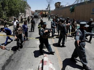 Afghan policemen inspect at the site of a blast in Kabul, Afghanistan May 31, 2017. REUTERS/Mohammad Ismail