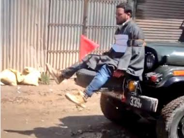 File image of Farooq Ahmad Dar strapped to an army jeep as a human shield. Screen grab from YouTube.