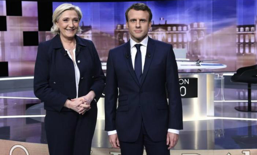 Le Pen and Macon during their final televised debate. Screengrab