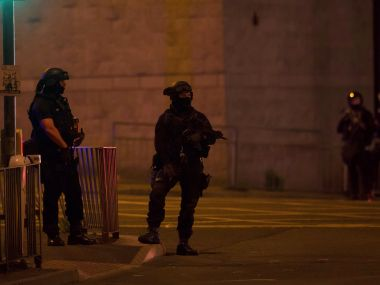 Armed police officers stand outside the Manchester Arena. Reuters