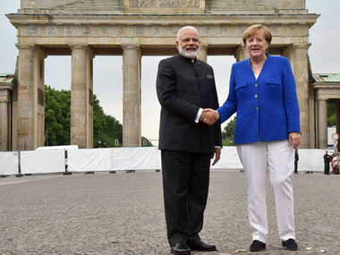 Prime Minister Narendra Modi and German Chancellor, Angela Merkel at Berlin's Brandenburg Gate, Germany on 30 May, 2017. Image courtesy PIB