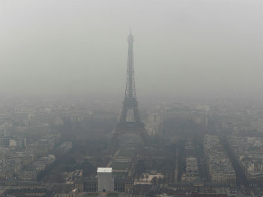 The Eiffel Tower is seen in smog in Paris. Reuters