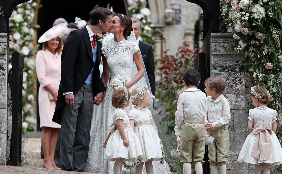 Pippa Middleton and James Matthews kiss after their wedding at St Mark's Church in Englefield, England Saturday, May 20, 2017. Middleton, the sister of Kate, Duchess of Cambridge married hedge fund manager James Matthews in a ceremony Saturday where her niece and nephew Prince George and Princess Charlotte was in the wedding party, along with sister Kate and princes Harry and William. AP