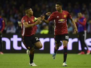 Manchester United's Marcus Rashford (right) celebrates his goal with Antonio Valencia. AFP