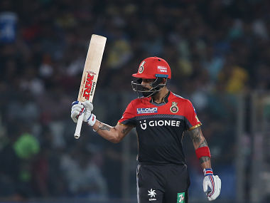 Royal Challengers Bangalore captain Virat Kohli raises his bat after reaching his fifty. SportzPics