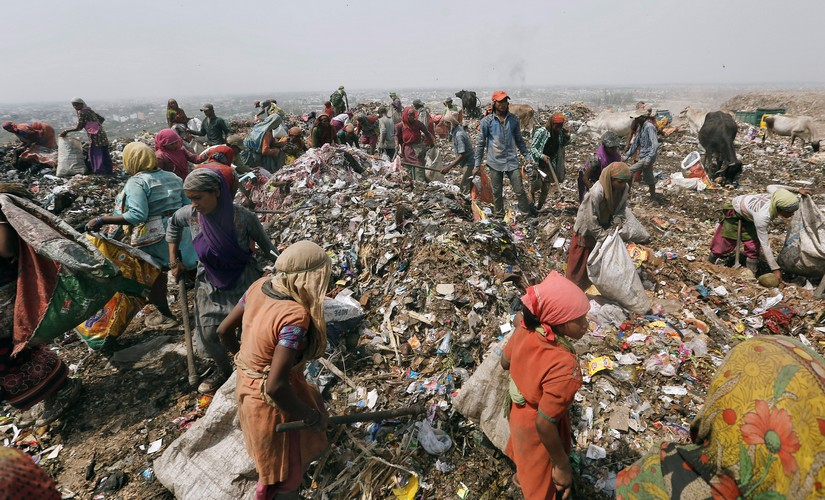 Ragpickers collect recyclables from a dump yard in New Delhi. Reuters