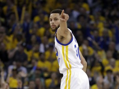 Golden State Warriors' Stephen Curry signals after scoring against the San Antonio Spurs. AP